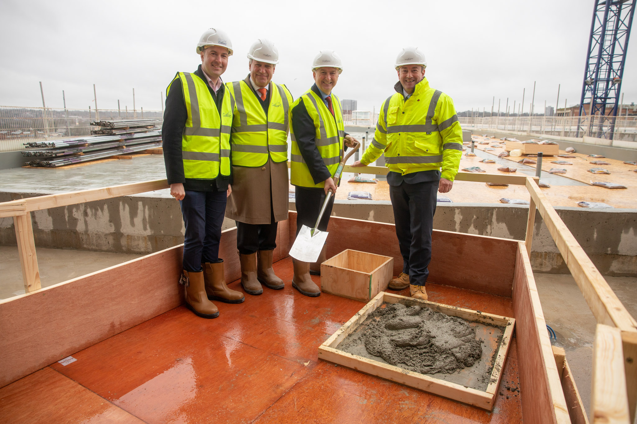 Cllr Gareth Moore, Conservative member for Erdington, Gerard Nock, chairman of Apsley House Capital, Cllr Ian Ward, Leader of Birmingham City Council, and Don O'Sullivan, chief executive of Galliard Homes at topping out ceremony for Timber Yard development in Birmingham